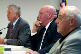 Montgomery County Precinct 2 Commissioner Charlie Riley listens beside County Judge Craig Doyal and Precinct 1 Commissioner Mike Meador during a budget workshop Tuesday.