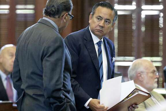Senator Carlos Uresti talks with Senator Jose Rodriguez on the floor  during the the special session on July 26, 2017.