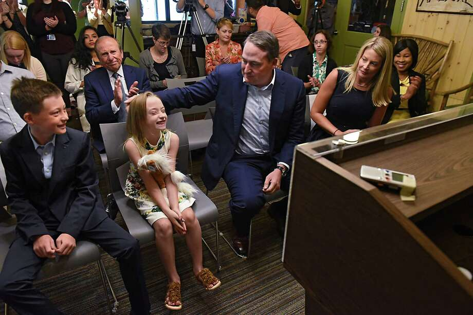 The Moser family, from left, Carson, 9, and Emery, 7, Robert and Lisa of Saratoga Springs are seen in the front row during a press conference at Albany Medical Center on Wednesday, July 26, 2017 in Albany, N.Y. The Mosers donated a $2.5 million dollar gift which will allow Dr. Oluwascun (Seun) Adetayo, right, and The Cleft-Craniofacial Center to serve more children from the region who are born every year with cleft, cranial and facial abnormalities. (Lori Van Buren / Times Union) Photo: Lori Van Buren / 20041112A