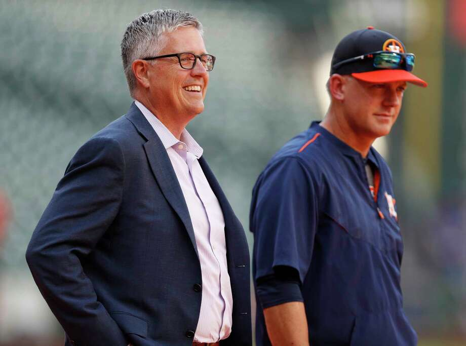 As MLB's non-waiver trade deadline arrives July 31, all eyes will be on Astros general manager Jeff Luhnow (left) to see what reinforcements he provides for manager A.J. Hinch's first-place team. Photo: Karen Warren, Staff Photographer / Internal