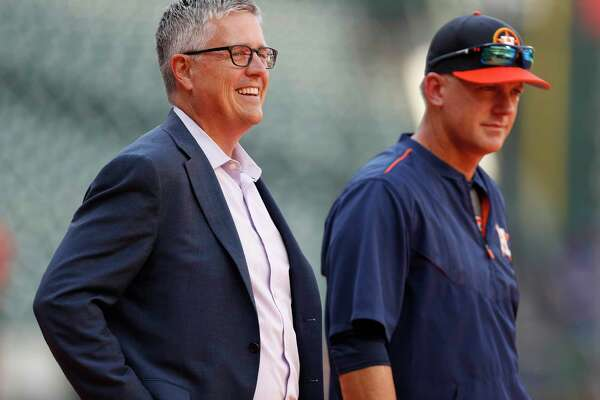 Houston Astros GM Jeff Luhnow talks with manager A.J. Hinch during batting practice before the start of an MLB baseball game at Minute Maid Park, Friday, April 7, 2017, in Houston.   ( Karen Warren / Houston Chronicle )
