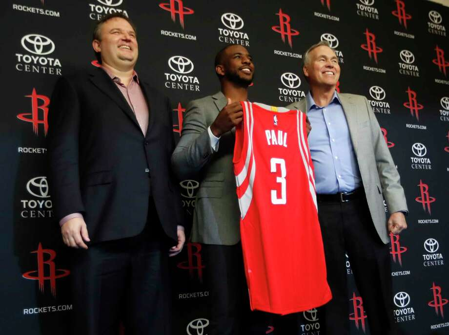 Rockets GM Daryl Morey, left, says he has no problem with Chris Paul continuing to shoot midrange jumpers because of the All-Star's accuracy. Photo: Karen Warren, Staff Photographer / Internal