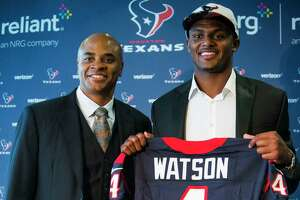Houston Texans top draft pick Deshaun Watson shows off his new Texans jersey as he poses for a photo with general manager Rick Smith following a news conference at NRG Stadium on Friday, April 28, 2017, in Houston. The Texans traded up in the NFL Draft with the Cleveland Browns to aquire the quarterback. ( Brett Coomer / Houston Chronicle )
