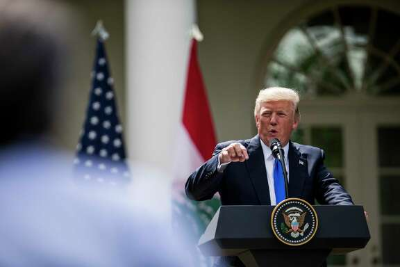 "President Donald Trump speaks during a joint news conference with Prime Minister Saad Hariri of Lebanon at the White House Tuesday. Trump's announcement on Twitter a day later that transgender people would be barred from the U.S. military ""in any capacity"" marked a sudden reversal of a policy that had evolved rapidly under the Obama Administration. (Justin Gilliland/The New York Times)"