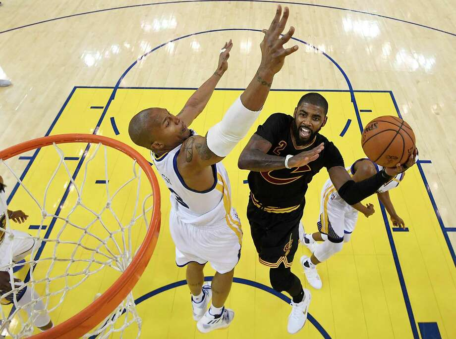 Cleveland Cavaliers guard Kyrie Irving, right, shoots against Golden State Warriors forward David West during the second half of Game 2 of basketball's NBA Finals in Oakland, Calif., Sunday, June 4, 2017. (Kyle Terada/Pool Photo via AP) Photo: Kyle Terada, POOL / Pool USA TODAY Sports Images