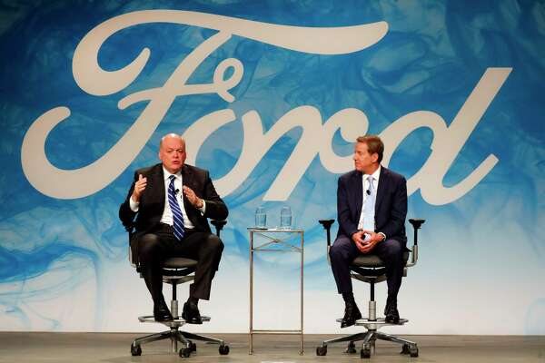 FILE - In this Monday, May 22, 2017, file photo, Bill Ford Jr., right, executive chairman of Ford Motor Company, introduces Jim Hackett as CEO, in Dearborn, Mich. The Ford Motor Co. reports earnings, Wednesday, July 26, 2017. (AP Photo/Paul Sancya, File)