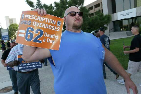 Clint Powell of Keller marches with other Teamsters as they protest Wednesday outside the McKesson Corp. shareholders meeting in Irving.