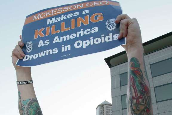Teamsters protest outside the McKesson Corp. shareholders meeting in Irving, Texas, Wednesday, July 26, 2017. (AP Photo/LM Otero)