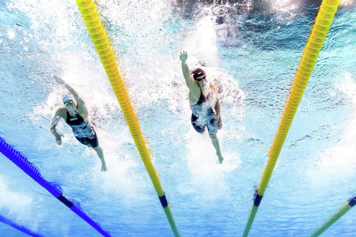 This picture taken with an underwater camera shows USA's Katie Ledecky (C) and Russia's Veronika Popova competing in the women's 200m freestyle final during the swimming competition at the 2017 FINA World Championships in Budapest, on July 26, 2017. / AFP PHOTO / Martin BUREAUMARTIN BUREAU/AFP/Getty Images