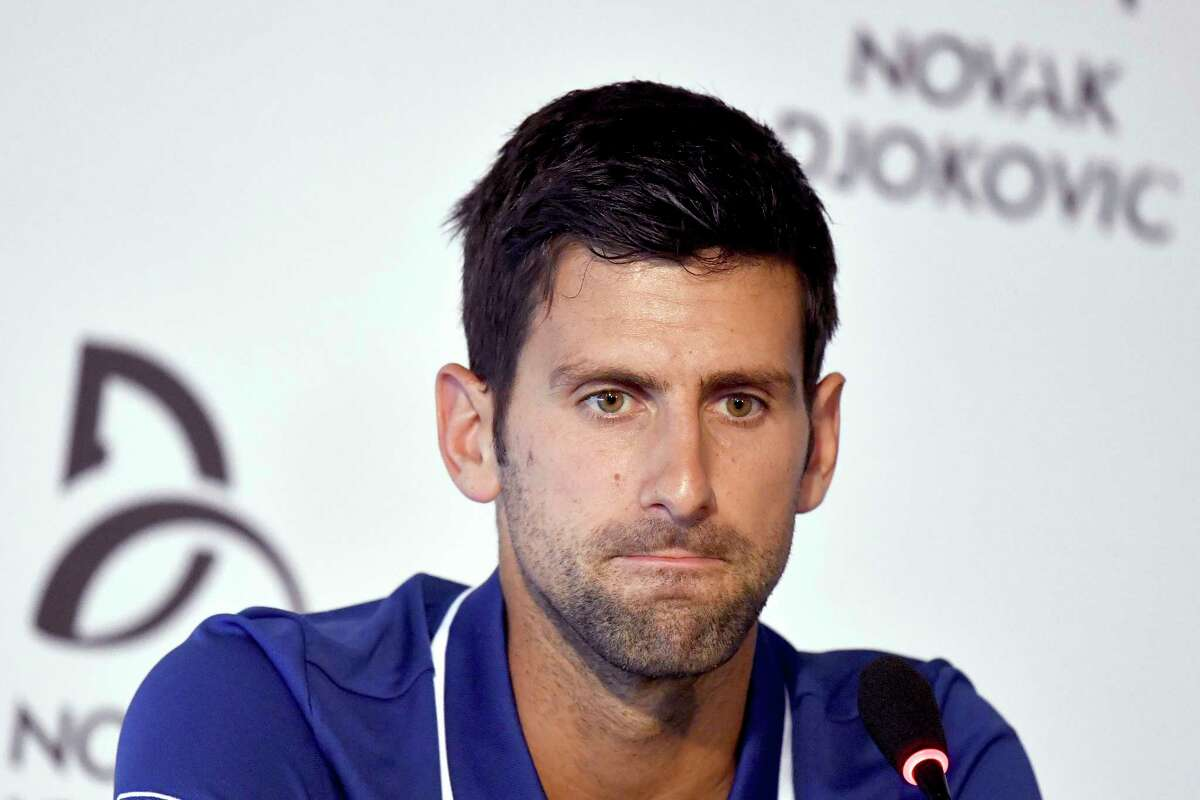 Tennis player Novak Djokovic pauses during a press conference in Belgrade, Serbia, Wednesday, July 26, 2017. Djokovic will sit out the rest of this season because of an injured right elbow, meaning he will miss the U.S. Open and end his streak of participating in 51 consecutive Grand Slam tournaments. (Andrej Isakovic, Pool Photo via AP) ORG XMIT: XDMV105