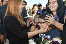 Norwalk resident Nury Chavarria who was on the verge of being deported for a decade back to Guatemala last week, has now been granted an emergency stay of that order, Wednesday, July 26, 2017, celebrates with her daughters, Lindsay, 18 and 9-year-old Hayley Chavarri at Iglesia de Dios Pentecostal Church in the Fair Haven section of New Haven.  (Catherine Avalone – Hearst Connecticut Media)