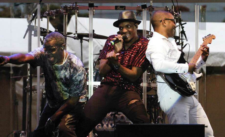 Lavell Evans, center, along with members of the band Kool & the Gang perform at Wednesday Nite Live in Columbus Park on Wednesday, July 26, 2017  in Stamford, Connecticut. Photo: Matthew Brown / Hearst Connecticut Media / Stamford Advocate