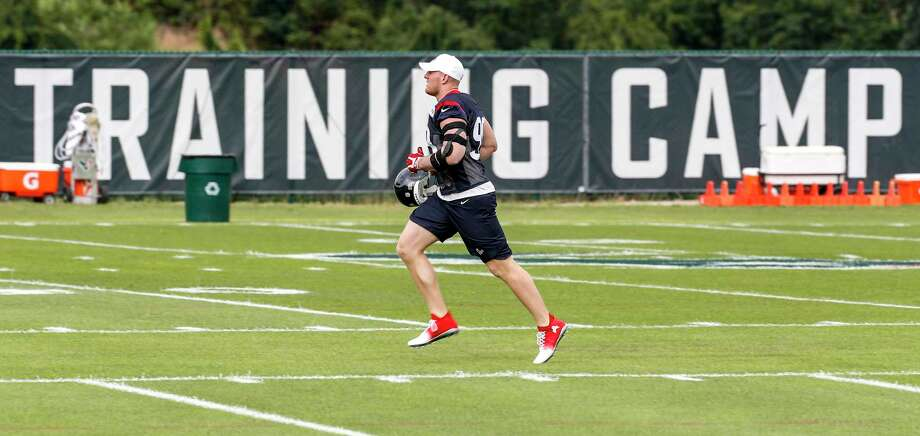 It's back to work for defensive star J.J. Watt as he trots onto the field for the first day of camp Wednesday in White Sulphur Springs, W.Va. Photo: Brett Coomer, Staff / © 2017 Houston Chronicle}