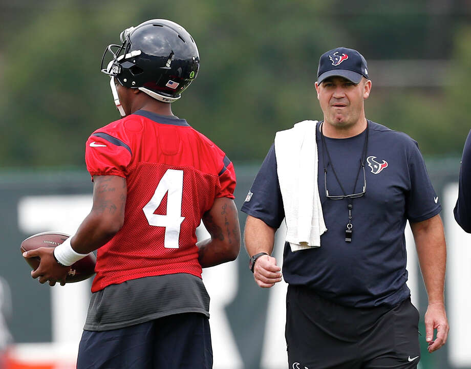 Houston Texans head coach Bill O'Brien walks past \ quarterback Deshaun Watson (4)warms up during the opening practice of training camp at the Greenbrier on Wednesday, July 26, 2017, in White Sulphur Springs, W.Va. ( Brett Coomer / Houston Chronicle ) Photo: Brett Coomer, Staff / © 2017 Houston Chronicle}