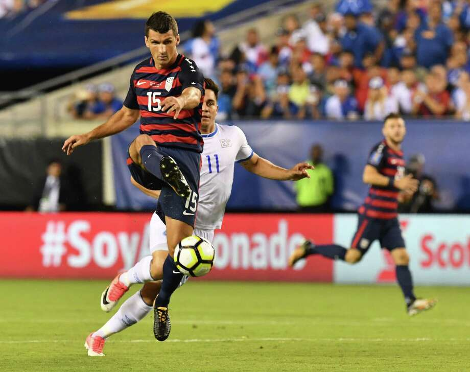 Eric Lichaj (L) of the USA is pursued by Roldolfo Zelaya (R) of El Salvador during their CONCACAF Gold Cup quarterfinal match at Lincoln Financial Field on July 19, 2017 in Philadelphia, Pennsylvania.  / AFP PHOTO / Nicholas KammNICHOLAS KAMM/AFP/Getty Images Photo: NICHOLAS KAMM, Contributor / AFP or licensors