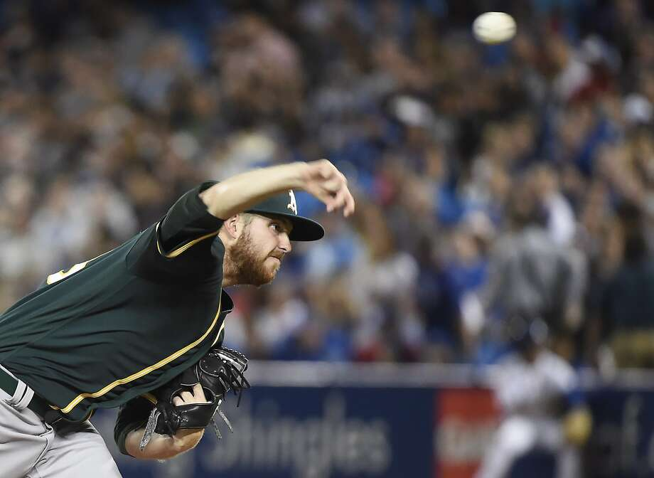 Oakland Athletics starting pitcher Paul Blackburn throws to a Toronto Blue Jays batter during the first inning of a baseball game Wednesday, July 26, 2017, in Toronto. (Nathan Denette/The Canadian Press via AP) Photo: Nathan Denette, Associated Press