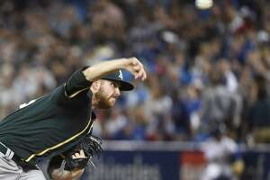 Oakland Athletics starting pitcher Paul Blackburn throws to a Toronto Blue Jays batter during the first inning of a baseball game Wednesday, July 26, 2017, in Toronto. (Nathan Denette/The Canadian Press via AP)