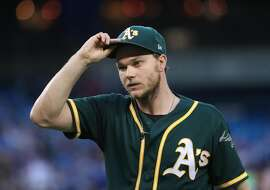 TORONTO, ON - JULY 25: Sonny Gray #54 of the Oakland Athletics walks to his dugout after retiring the side in the third inning during MLB game action against the Toronto Blue Jays at Rogers Centre on July 25, 2017 in Toronto, Canada. (Photo by Tom Szczerbowski/Getty Images)
