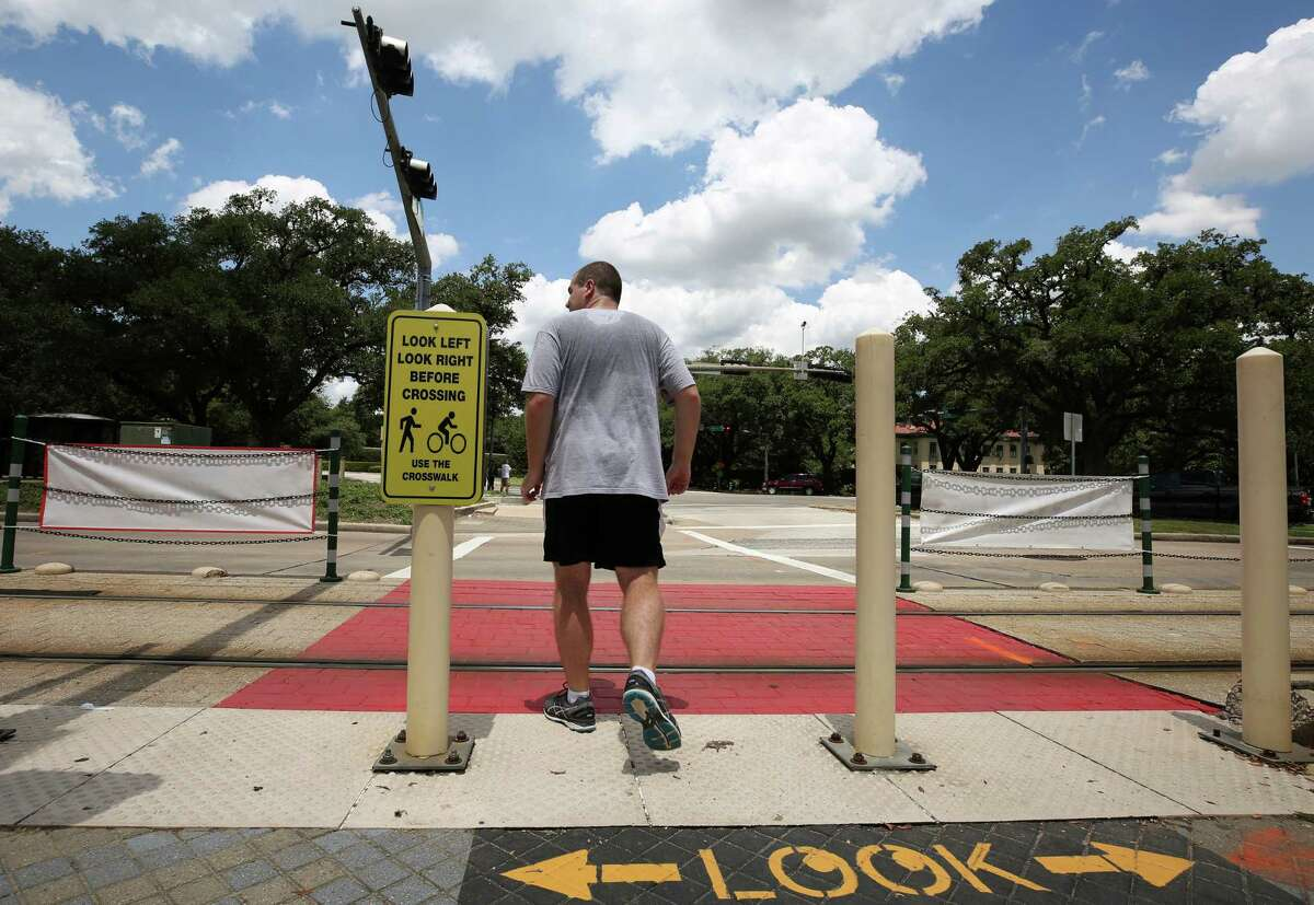 Metropolitan Transit Authority, Rice University, and the City of Houston have collaborated to make the crosswalk at the Hermann Park / Rice train stop safer, adding signs and painting the train tracks sections red, seen on July 26.