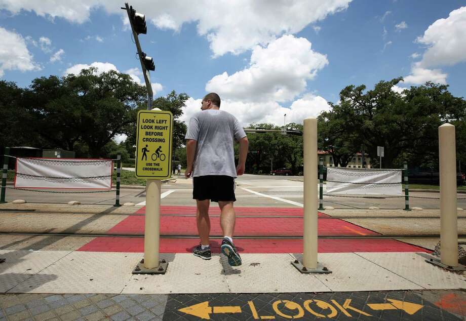 Metro Rail, Rice University, and the City of Houston have collaborated to make the crosswalk at the Hermann Park / Rice train stop safer, adding signs and painting the train tracks sections red, as seen on July 26. Photo: Godofredo A. Vasquez, Staff / Godofredo A. Vasquez