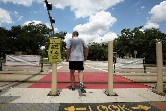 METRO Rail, Rice University, and the City of Houston have collaborated to make the crosswalk at the Hermann Park / Rice train stop safer, adding signs and painting the train tracks sections red Wednesday, July 26, 2017, in Houston.