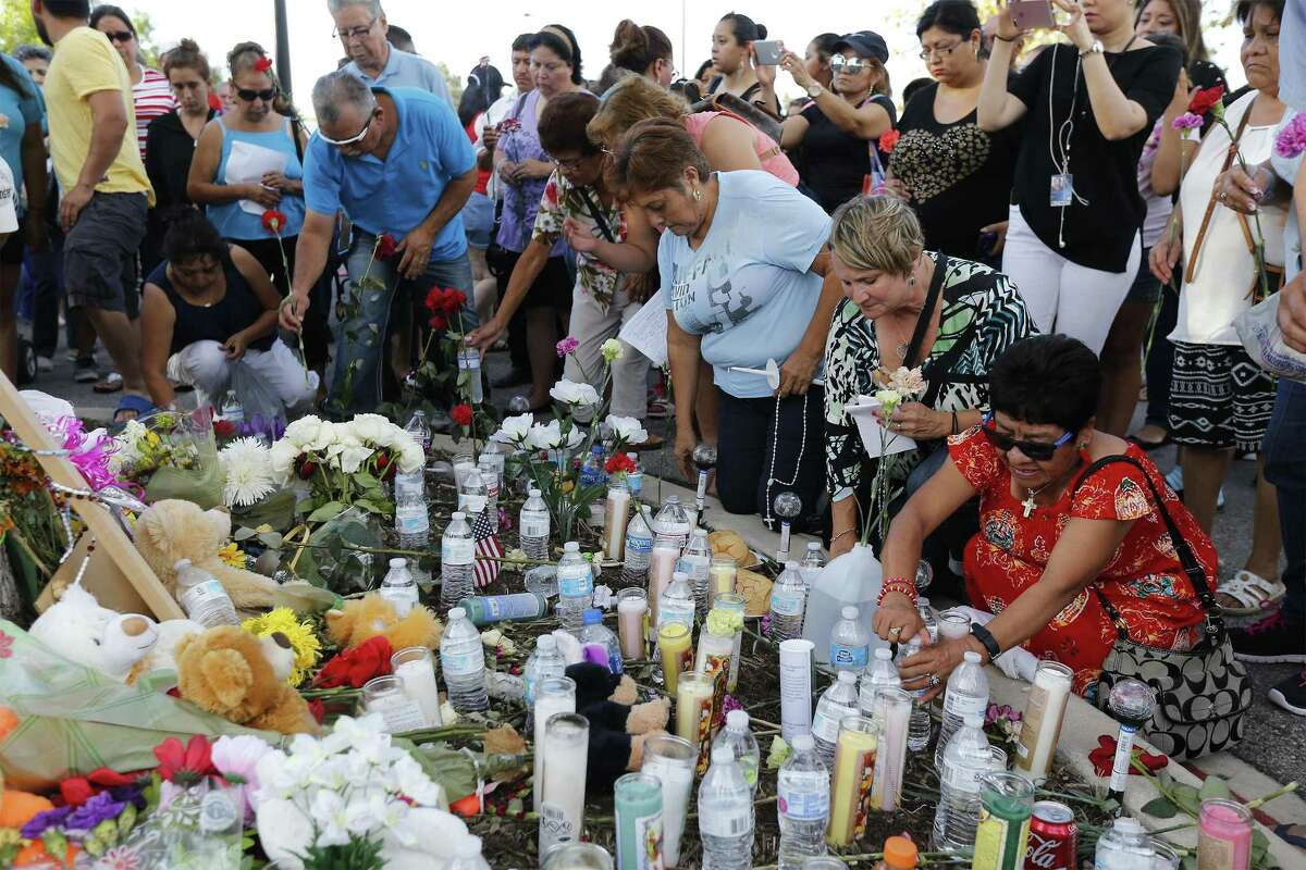 Area residents left water, food and candles at a memorial created for the victims of a smuggling venture turned deadly recently. More than 50 mourners gathered at the site at the Walmart located on the southside of town and recited the rosary while holding candles and flowers.