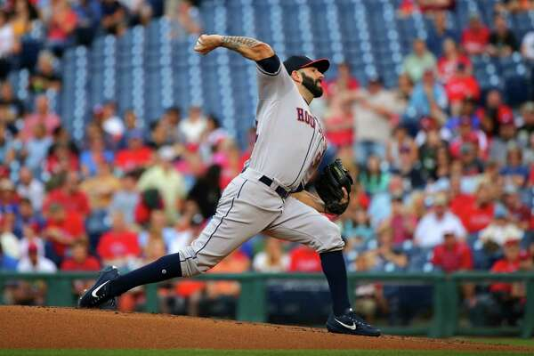 PHILADELPHIA, PA - JULY 26: Starting pitcher Mike Fiers #54 of the Houston Astros throws a pitch in the first inning during a game against the Philadelphia Phillies at Citizens Bank Park on July 26, 2017 in Philadelphia, Pennsylvania.