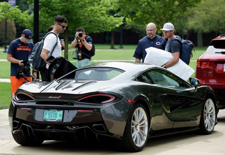 It pays to make it in the NFL, even if you're only seeing the field for a few non-contact plays per game. That was evident at Bears camp on Wednesday as punter Pat O'Donnell, left, and kicker Connor Barth draw attention for arriving in a McLaren, a line of cars whose basic model begins at $180,000. Photo: Nam Huh, STF / Copyright 2017 The Associated Press. All rights reserved.