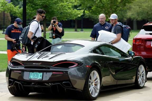 It pays to make it in the NFL, even if you're only seeing the field for a few non-contact plays per game. That was evident at Bears camp on Wednesday as punter Pat O'Donnell, left, and kicker Connor Barth draw attention for arriving in a McLaren, a line of cars whose basic model begins at $180,000.
