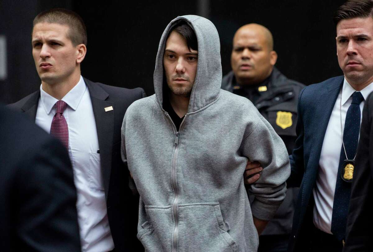 FILE - In this Dec. 17, 2015, file photo, Martin Shkreli, center, the former hedge fund manager under fire for buying a pharmaceutical company and ratcheting up the price of a life-saving drug, is escorted by law enforcement agents in New York after being taken into custody following a securities probe. Jurors heard testimony from the government's last witness on Tuesday, July 25, 2017, a day after Shkreli's lawyer told the court his client won't take the witness stand during his securities fraud trial. (AP Photo/Craig Ruttle, File)