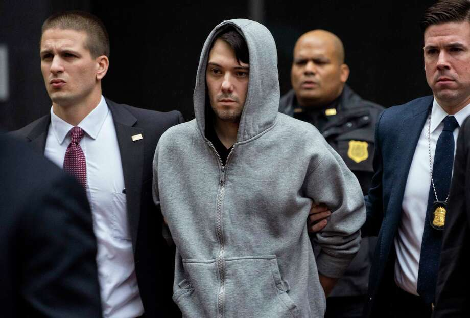 FILE - In this Dec. 17, 2015, file photo, Martin Shkreli, center, the former hedge fund manager under fire for buying a pharmaceutical company and ratcheting up the price of a life-saving drug, is escorted by law enforcement agents in New York after being taken into custody following a securities probe. Jurors heard testimony from the government's last witness on Tuesday, July 25, 2017, a day after Shkreli's lawyer told the court his client won't take the witness stand during his securities fraud trial. (AP Photo/Craig Ruttle, File) Photo: Craig Ruttle, FRE / FR61802 AP