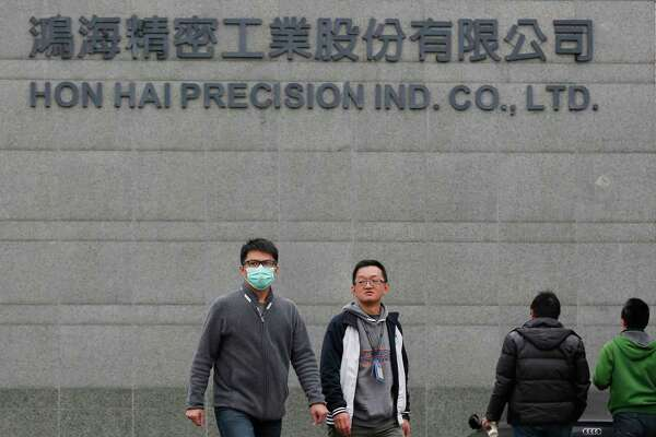 Employees leave Hon Hai Precision Industry Co., also known as Foxconn, in New Taipei City, Taiwan. The company plans a Wisconsin factory to open by 2020.