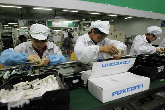 Employees work on the production line at the Foxconn complex in the Chinese city of Shenzhen.
