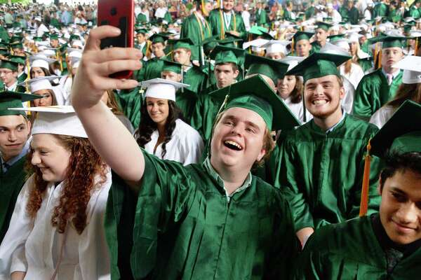 Brady Asadorian takes a selfie during Commencement for Shenendehowa High School Class of 2017 at SPAC Friday June 23, 2017 in Saratoga Springs, NY.   (John Carl D'Annibale / Times Union)