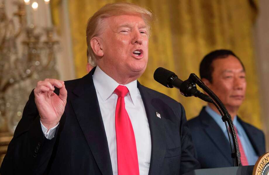 President Trump followed through Friday on his promise to remove transgender Americans from military service, issuing an order for an outright ban to take effect in seven months — but appearing to leave room for military leaders to talk him out of it. Photo: SAUL LOEB / AFP or licensors
