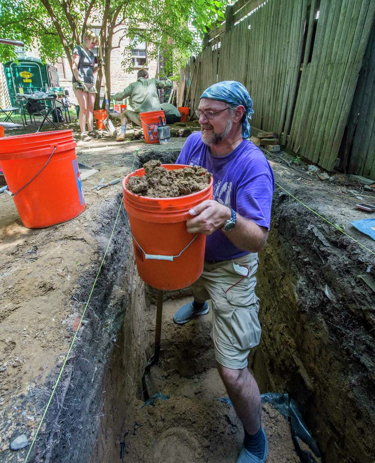 Professor Bradley Russell pulls up a bucket of dirt which may contain artifacts during the Archeology Filed School, a hands-on summer camp in which students learn about shelves of African-Americans in the Early 1800's on Wednesday, July 19, 2017, in Albany, N.Y. (Skip Dickstein/Times Union)