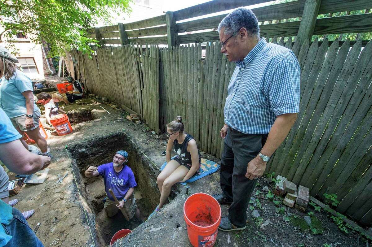 Paul Stewart, Co-Founder, Underground Railroad History Project, oversees Campers and instructors as they work on their dig sites during the Archeology Filed School, a hands-on summer camp in which students learn about shelves of African-Americans in the Early 1800's on Wednesday, July 19, 2017, in Albany, N.Y. (Skip Dickstein/Times Union)