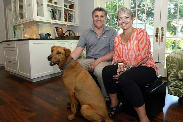 Home owners Charles Wintrub and Tammy Davis with Zuul, the family pet on Friday, July 19, 2017 in Stamford, Connecticut.