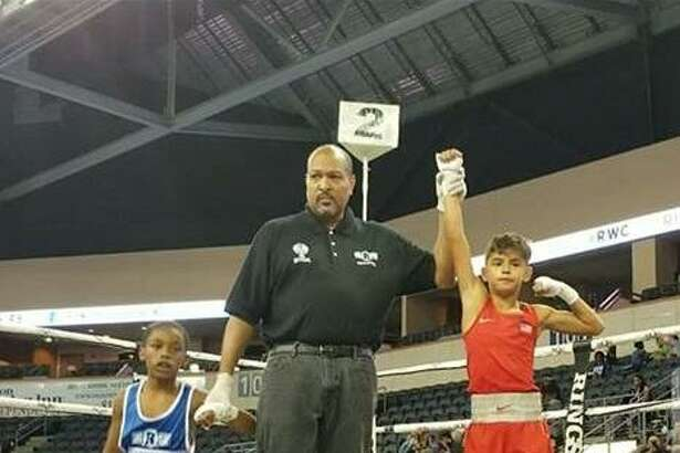 Defending RWC champion Mason Vela of Boxing Pride Fitness beat Kaleb Johnson of Raleigh, North Carolina in the 70-pound, Boys' Pee Wee Open 8-10 division at the 2017 Ringside World Championships in Independence, Missouri