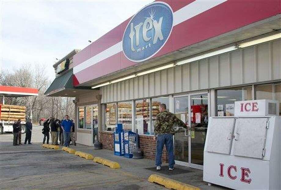 A customer enters Trex Mart as members of the news media gather in Dearborn, Mo., Thursday, Nov. 29, 2012. Trex Mart sold one of last night's winning Powerball tickets. (AP Photo/Orlin Wagner) Photo: AP / AP