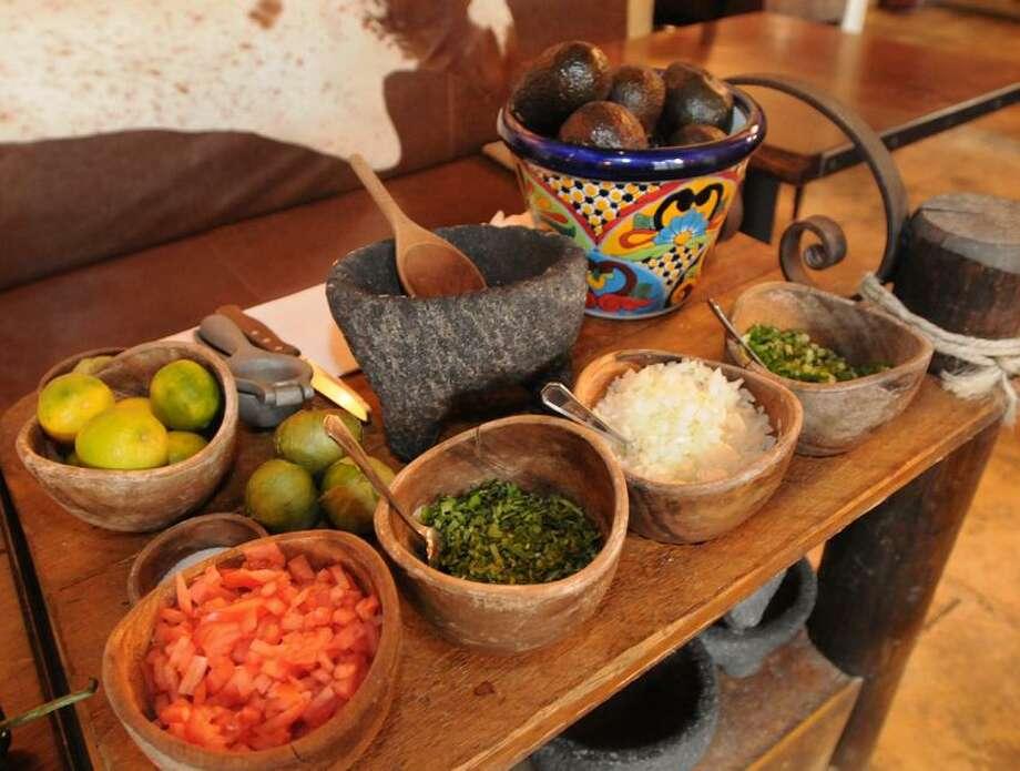 The waitstaff prepares Guacamole tableside at Oaxaca Kitchen Bar & Restaurant in New Haven.