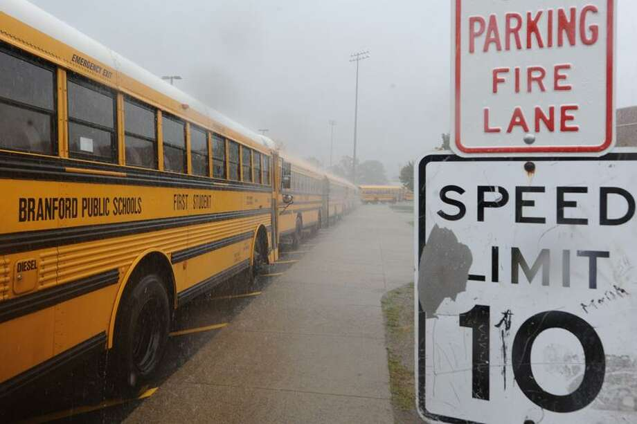 School buses lined up at Branford High School in pouring rain waiting for school to dismiss. vm Williams/Register