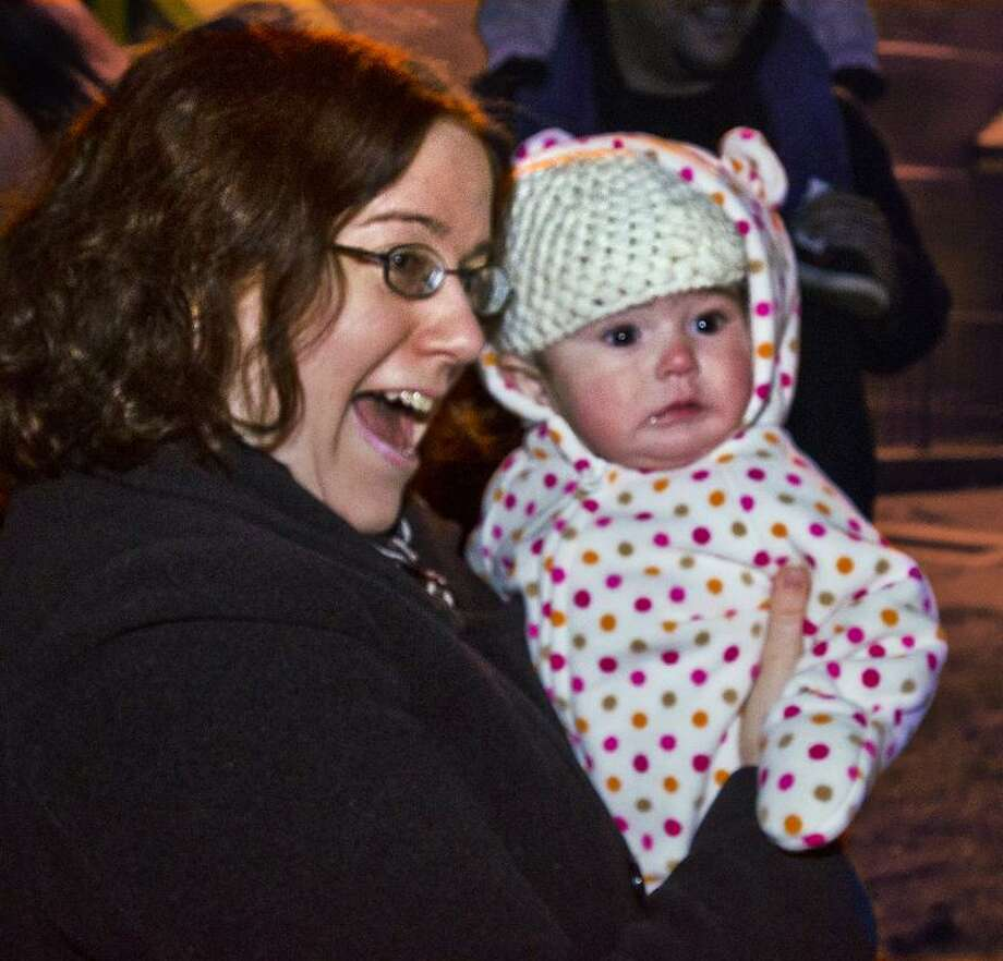 ANSONIA-Ann Marie Gonzalez and her daughter Bridgette watch as the tree is lit in Veterans Park.  Bridgette is 5 months old. They are from Ansonia. Melanie Stengel/Register