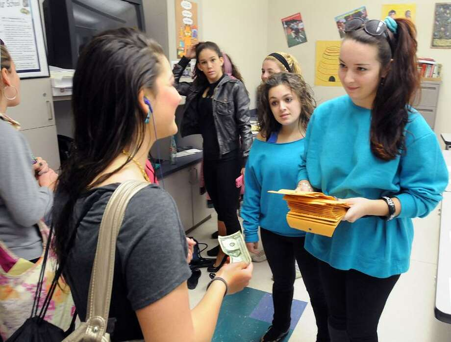 East Haven High School: Students with ROPES (Respect, Opportunity, Participation, Education, Sensitivity) including Maria Raucci center and Meagan Ham right, collected donations for victims of Sandy. Marissa Vittorio left stopped by to donate. Mara Lavitt/New Haven Register11/19/12