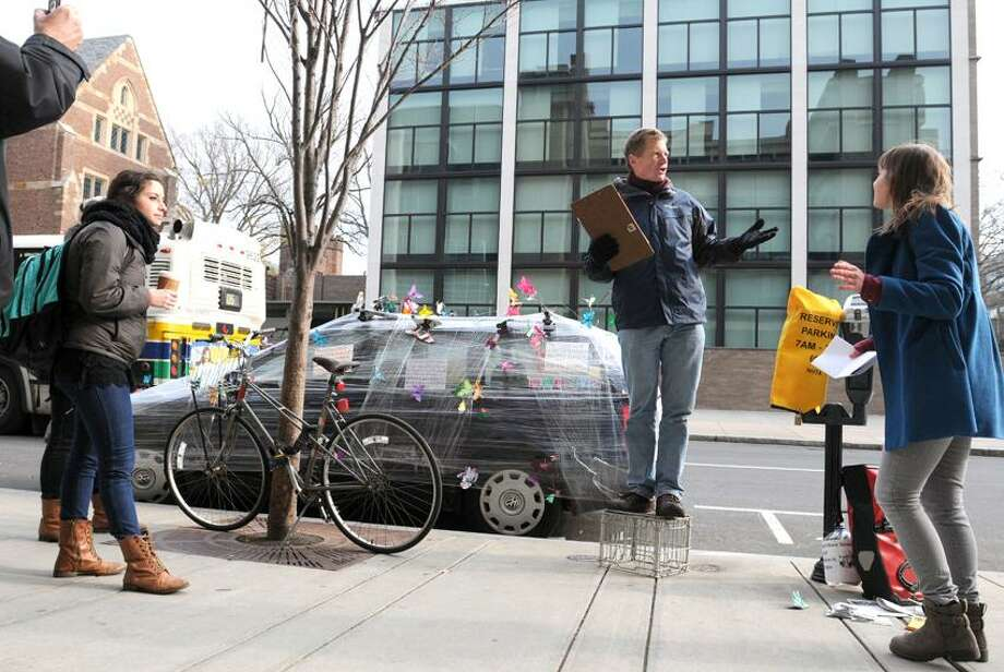 "Chris Schweitzer on his ""soap box"", right, during a street art exhibit and a community public forum  ""speak out""  on climate change Friday, November 30, 2012 on York Street by Chapel Street in New Haven during a project of the New Haven / Leon Sister Project.   Photo by Peter Hvizdak / New Haven Register Photo: New Haven Register / ©Peter Hvizdak /  New Haven Register"