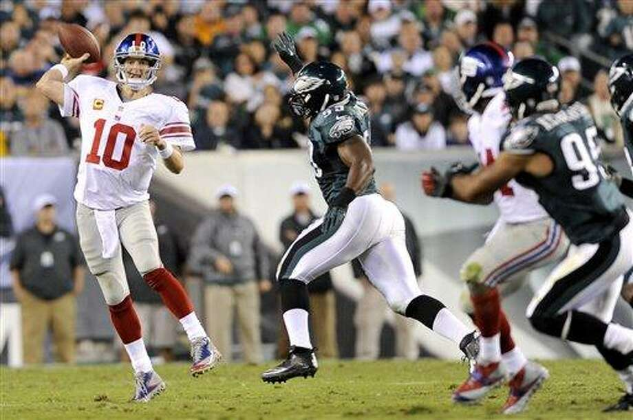 New York Giants quarterback Eli Manning (10) makes a pass against the Philadelphia Eagles during the first half of an NFL football game Sunday, Sept. 30, 2012, in Philadelphia. (AP Photo/Michael Perez) Photo: AP / FR168006 AP