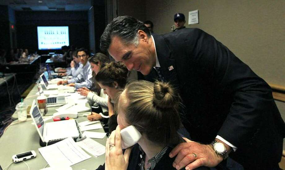 """Republican presidential candidate, former Massachusetts Gov. Mitt Romney, visits with campaign workers in his """"War Room"""" with advisers during the Florida primary election at the Tampa Convention Center in Tampa, Fla., Tuesday. Associated Press Photo: AP / AP"""