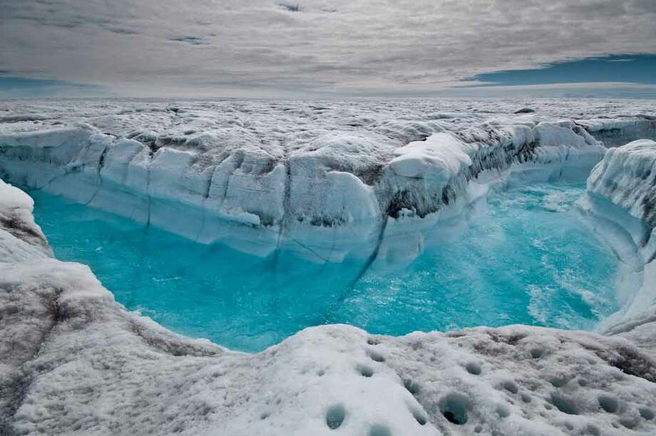 This July 4, 2012 image provided by Ian Joughin, shows surface melt water rushing along the surface of the Greenland Ice Sheet through a supra-glacial stream channel, southwest of Ilulissat, Greenland. Polar ice sheets are now melting three times faster than in the 1990s, but so far that's added just less than half an inch to already rising global sea levels, a new giant scientific study says. While the amount of sea level rise isn't as bad as some earlier worst case scenarios, the acceleration of the melting, especially in Greenland, has ice scientists worried. (AP Photo/Ian Joughin) Photo: ASSOCIATED PRESS / The Associated Press2012