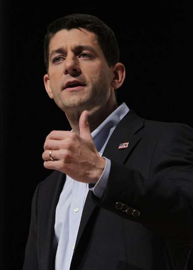 Republican vice presidential candidate, Rep. Paul Ryan, R-Wis., speaks at the U.S. Sportsmen's Alliance's annual banquet Saturday, Sept. 29, 2012, in Columbus, Ohio. (AP Photo/Jay LaPrete) Photo: AP / AP2012