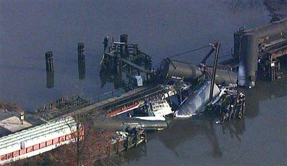 In this frame grab from video provided by WTXF Fox Philadelphia, crews work the scene where a freight train carrying hazardous chemicals derailed over Mantua Creek, Friday, Nov. 30, 2012, in Paulsboro, N.J. At least two tanker cars toppled into the creek causing a leak of hazardous vinyl chloride into the air Friday. Dozens of people went to a hospital complaining of breathing problems. (AP Photo/WTXF Fox Philadelphia) Photo: AP / WTXF Fox Philadelphia